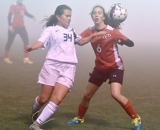 (Brad Davis/The Register-Herald) WVU Tech's Maria Gonzalez battles for possession with Rio Grande's Daniella DeSousa during a foggy Wednesday night at the YMCA Paul Cline Memorial Sports Complex.