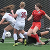 (Brad Davis/The Register-Herald) Cabell Midland's Emilie Charles, right, rushes in for a scoring chance on the University net during the Class AAA Girls State Soccer Championship Game Saturday afternoon at the YMCA Paul Cline Memorial Sports Complex.
