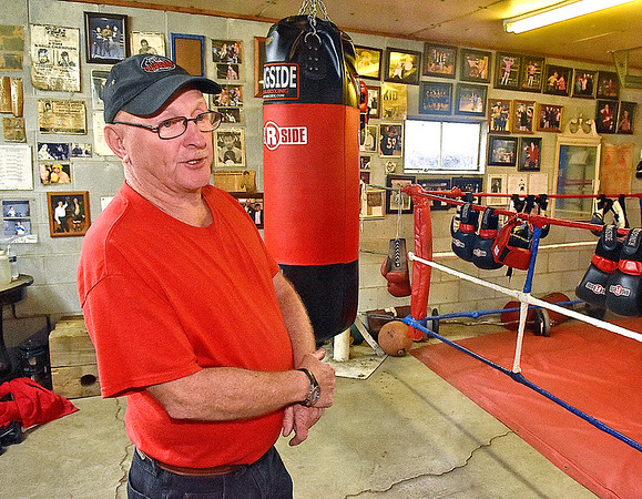(Brad Davis/The Register-Herald) Long time boxing trainer Carl Murdock talks about the rich, little known history of the local boxing scene inside his garage gym at his Mount Hope home Monday evening. The 70-year-old Murdock is widely considered to be one of the most effective at grooming local scrappers into polished boxers that win matches, with his Mount Hope Boxing Club producing some 40 champions male and female over a 30 plus year period. The walls of his garage gym are parts local boxing museum, hall of fame and champions' club. Each fighter who trains with him aspires to be on his wall one day.