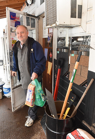 Roger Clay, of Pettry Bottom, exits the Charles B. Jarrell General Store on Coal River Road in Dry Creek.<br /> (Rick Barbero/The Register-Herald