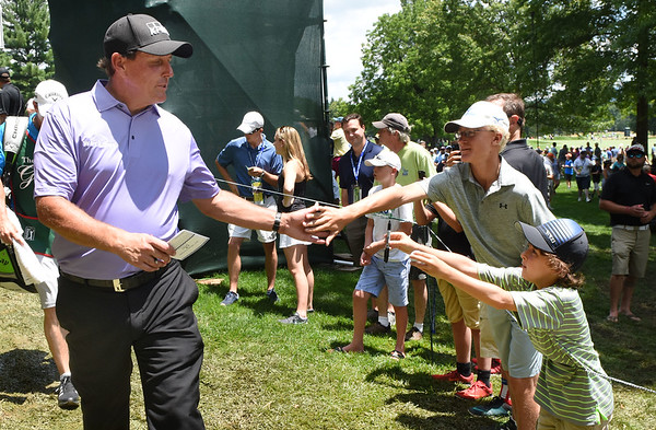 Phil Mickelson greets some spectators after finihing his round on the 9th hole during the second round of The Greenbrier Classic.<br /> (Rick Barbero/The Register-Herald)
