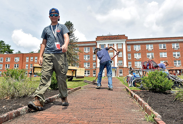 (Brad Davis/The Register-Herald) Scout Michael Nicht from Troop 2320 out of Cincinnati, Ohio notices the camera as he walks by during project work at Jackie Withrow Hospital Thursday afternoon in Beckley.