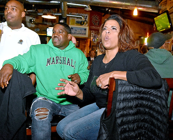 (Brad Davis/The Register-Herald) Kristin Anderson, mother of former Woodrow Wilson and current Thundering Herd linebacker Chase Hancock, reacts to events on the field as she, husband Ted, middle, and her cousin Eric Thomas, far left, watch Chase and Marshall take on Colorado State in the New Mexico Bowl Saturday night at Calacino's Pizzeria.