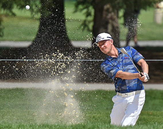 (Brad Davis/The Register-Herald) Jonas Blixt chips from a bunker on #11 during second round Greenbrier Classic action Friday afternoon in White Sulphur Springs.
