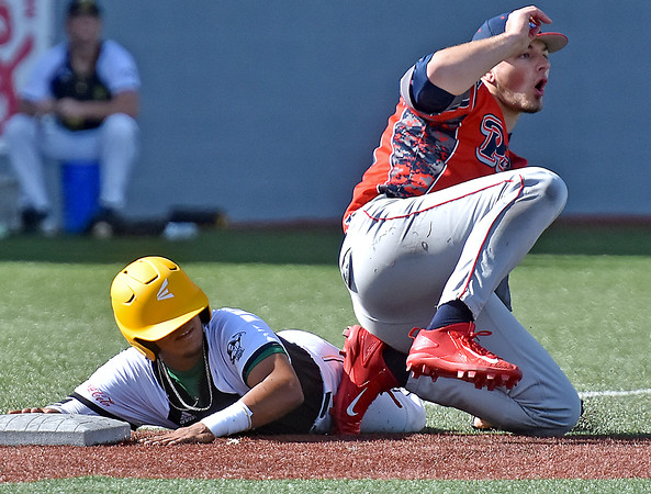 (Brad Davis/The Register-Herald) Miners baserunner Edwin Bonilla looks up to see he's been called safe, much to the disagreement of Chillicothe pitcher Andrew Reisinger, who thought he'd made the tag Sunday afternoon at Linda K. Epling Stadium.