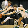 (Brad Davis/The Register-Herald) Independence's Tyler Haga and Wyoming East's Logan Mullins rush for a loose ball during Big Atlantic Classic action Wednesday night at the Beckley-Raleigh County Convention Center.