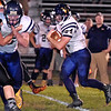 (Brad Davis/The Register-Herald) Greenbrier West's Colton Kessler carries the ball Friday night in Hinton.