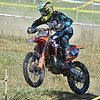 (Brad Davis/The Register-Herald) A competitor catches some air as they tear through a section of the course during Sprint Enduro Series dirt bike racing Sunday afternoon at Hidden Valley Golf in Glen Daniel.