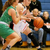 (Brad Davis/The Register-Herald) Summers County's Hannah Taylor drives to the basket as Charleston Catholic's Maddie Blaydes defends during the Lady Bobcats' win over the Irish Saturday night in Hinton.