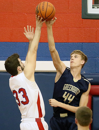 (Brad Davis/The Register-Herald) Independence's Logan Kelly's short-range shot attempt is thwarted by a block from Greenbrier West's Collin O'Dell Wednesday night in Coal City.
