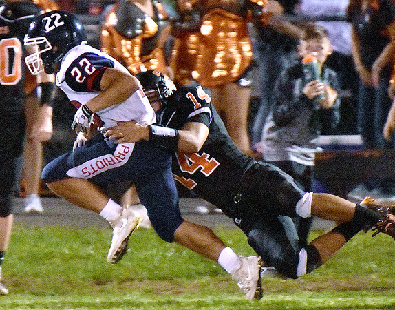 (Brad Davis/The Register-Herald) Independence's Robbie Cochran is caught by Summers County defender Christian Pack Friday night in Hinton.