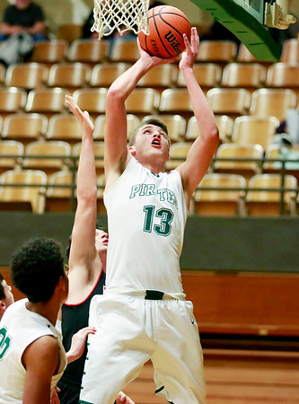 Fayetteville's Will Fenton (13) attempts a shot over Webster County players during their game Tuesday at the Soldiers & Sailors Memorial Building in Fayetteville. (Chris Jackson/The Register-Herald)