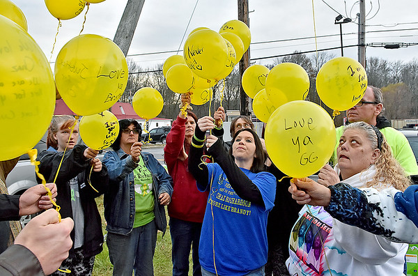 (Brad Davis/The Register-Herald) Mother Leisa Wellington, lower right corner, joins friends and family as they prepare to release balloons into the air with messages of love and hope for son Chaz Richardson, who has been missing since December 3rd of 2015 during a vigil and continued awareness gathering Wednesday evening in Glen Daniel next to the Whitesville State Bank.