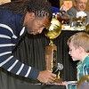 (Brad Davis/The Register-Herald) Young fan Calix Burns, 6, gets a chance to ask Arizona Cardinals receiver Larry Fitzgerald a question during a Q&A session with fans during the Big Atlantic Classic Tip-Off Banquet Sunday afternoon at the Beckley-Raleigh County Convention Center.