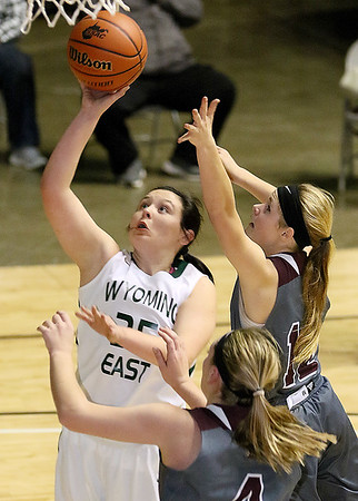 (Brad Davis/The Register-Herald) Wyoming East's Haley Butcher drives to the basket as George Washington's Lauren Harmison (#4) and Katy Darnell defend during Big Atlantic Classic action Wednesday night at the Beckley-Raleigh County Convention Center.