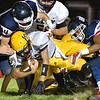 (Brad Davis/The Register-Herald) Clay County ball carrier Alex Grose is gang tackled by the Independence defense Friday night in Coal City.