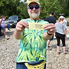(Brad Davis/The Register-Herald) Ducky enthusiast and one of the event's organizers Dwight Emrich poses for a quick photo prior to the start of the CFM House Museum's Great Rubber Ducky Race August 8 in Hinton.