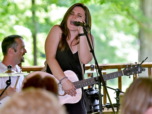 (Brad Davis/The Register-Herald) Krista Hughes performs during Daniel Vineyards' Spring Wine Festival Saturday afternoon in Crab Orchard.
