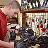 (Brad Davis/The Register-Herald) 14-year-old Joe Watson works on one of his gas powered, high performance R.C. cars Sunday afternoon at his Wyco Hollow Road home.