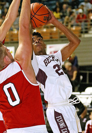 (Brad Davis/The Register-Herald) Woodrow Wilson's Mikey Penn drives to the basket as Hurricane's Steven Shine defends during the Flying Eagles' win over the Redskins Saturday night at the Beckley-Raleigh County Convention Center.