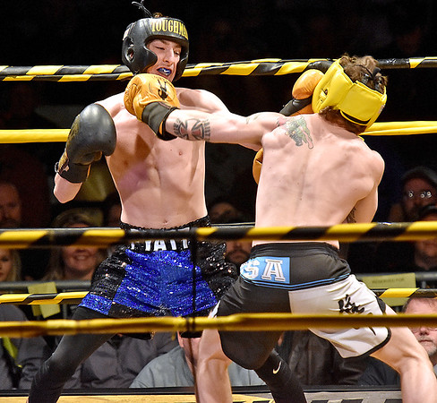 (Brad Davis/The Register-Herald) Oak Hill High School senior Noah Pyatt, left, battles Huntington's Adam Christian during Original Toughman action Saturday night at the Beckley-Raleigh County Convention Center. Pyatt would win the fight.