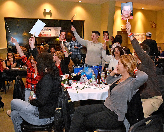 (Brad Davis/The Register-Herald) Attendees cheer on their favorites during the annual Hunks in Heels fundraising event for the Women's Resource Center Friday night at the Beckley Moose Lodge.