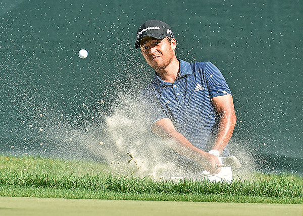 (Brad Davis/The Register-Herald) Xander Schauffele chips onto the #18 green from a bunker during third round Greenbrier Classic action Saturday afternoon in White Sulphur Springs.