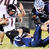 Meadow Bridge's Kobe Rozell (88) tackles Webster County's Dustin Williams (1) during their high school football game Friday in Meadow Bridge. (Chris Jackson/The Register-Herald)