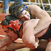 (Brad Davis/The Register-Herald) Greenbrier West's Logan Foley takes on Oak Hill's Elijah Evans Jimmy Pritt in a 182-pound weight class matchup during the West Virginia Army National Guard Duals Friday afternoon at the Beckley-Raleigh County Convention Center. West's Foley would win the match.