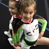 Marlee Wills and Harlow Hanson, with GymFinity All-Stars team, Cosmo, preparing for a  traveling cheerleading competition.