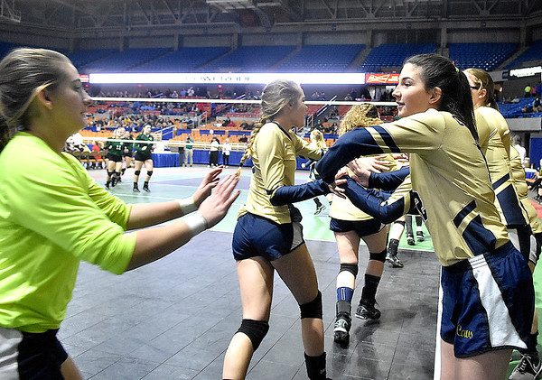 (Brad Davis/The Register-Herald) The Lady Cavs get fired up prior to Greenbrier West's match against East Hardy during State Volleyball Tournament action Friday morning at the Charleston Civic Center.