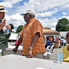 (Brad Davis/The Register-Herald) Resident Hazel Cousins, right, looks on as White Sulphur Springs mayor Lloyd Haynes, middle, chats with Mark Gillespie during the town's Family Fair Saturday afternoon.