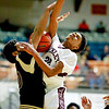 Woodrow Wilson's Mikey Penn is fouled on a layup attempt by a George Washington player during the second quarter of their basketball game at the Beckley-Raleigh County Convention Center in Beckley on Tuesday. (Chris Jackson/The Register-Herald)