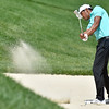 (Brad Davis/The Register-Herald) Tony Finau chips onto the #8 green from a bunker during final round Greenbrier Classic action Sunday afternoon in White Sulphur Springs.