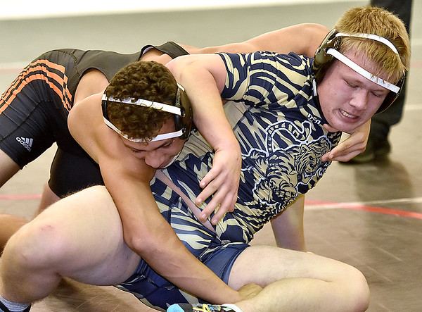(Brad Davis/The Register-Herald) Shady Spring's Joe Dye takes on Richwood's Hayden Burdette in a 180-pound weight class matchup during the Raider Rumble Saturday afternoon in Glen Daniel. Richwood's Burdette would win the match.