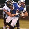 (Brad Davis/The Register-Herald) Midland Trail ball carrier Thomas Ferris is wrapped up and taken down by Summers County defender Andrew Richmond Friday night at Nicholas County High School.