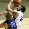 (Brad Davis/The Register-Herald) Woodrow Wilson's Tarek Payne drives to the basket as Princeton's Christian Shaffer defends during Big Atlantic Classic action Friday night at the Beckley-Raleigh County Convention Center.