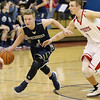 (Brad Davis/The Register-Herald) Greenbrier West's Noah Midkiff speeds past Independence's Tyler Haga Wednesday night in Coal City.