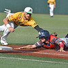 (Brad Davis/The Register-Herald) Chillicothe's Neil Lambert dives into third and would be called safe as Miners 3rd baseman Dan Ward reaches out to try and make the tag during a loss to the Paints Sunday afternoon at Linda K. Epling Stadium.