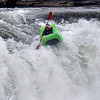(Brad Davis/The Register-Herald) A rafter speeds down a waterfall during the freestyle portion of Kanawaha Falls Fest Thursday morning in Gauley Bridge. The event was sponsored by ACE Adventure Gear and featured a whitewater kayak race, freestyle kayaking and even a photography contest open to spectators.