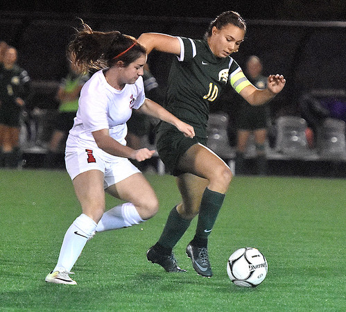 (Brad Davis/The Register-Herald) Greenbrier East's Abbie Bartenslager battles for possession with Cabell Midland's Sophia Anton during Class AAA Girls State Soccer Tournament action Friday night the YMCA Paul Cline Memorial Sports Complex.