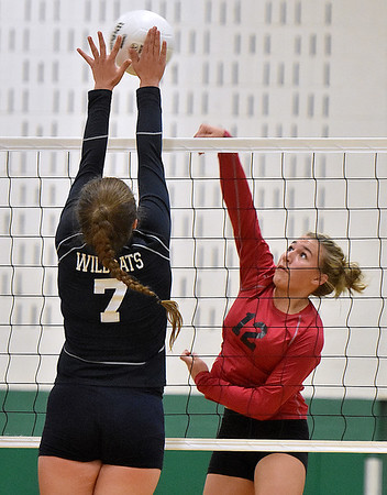 (Brad Davis/The Register-Herald) Liberty's Morgan Marty, right, leaps to hit the ball as Meadow Bridge's Shauna Harless is there to block it Wednesday night at Fayetteville High School.