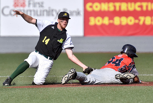 (Brad Davis/The Register-Herald) Miners 2nd baseman Chad Ramsey nearly catches Chillicothe baserunner Tanner Piechnick snoozing on catcher Cole Fowler's pickoff throw, but he makes it back to 2nd Sunday afternoon at Linda K. Epling Stadium.
