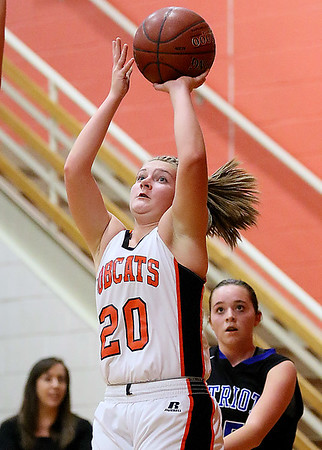 (Brad Davis/The Register-Herald) Summers County's Tiffani Cline drives and scores against Midland Trail Thursday night in Hinton.