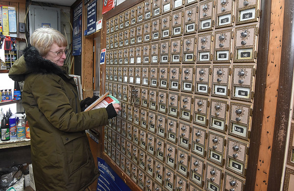 Nancy Alderman, of Dry Creek, grabs her mail at the Charles B. Jarrell General Store on Coal River Road in Dry Creek. The post Office was established  on June 9, 1884. The official name was Jupiter and was changed to Dry Creek on October 31, 1884.<br /> (Rick Barbero/The Register-Herald)