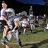(Brad Davis/The Register-Herald) Local youths join the Renegades as they take the field for a home game against Nicholas County Friday night in Clear Fork.