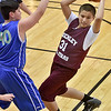 (Brad Davis/The Register-Herald) Beckley All-Stars' Anthony Rodriguez looks for an open teammate as he's pressured by Milton's Michael Lunsford during their fifth-grade Biddy Buddy Tournament game Friday afternoon inside the Van Meter Gym on the WVU Tech campus. Milton won the game 37-27.