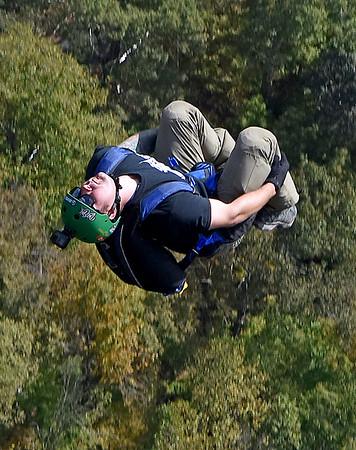 (Brad Davis/The Register-Herald) A B.A.S.E. jumper backflips off the platform during Bridge Day Saturday afternoon.