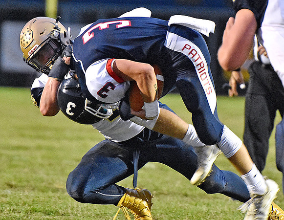 (Brad Davis/The Register-Herald) Shady Spring's Dylan McCall wrangles Independence quarterback Matt McKinney to the ground Friday night in Coal City.