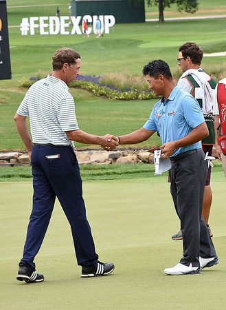 Davis Love lll shakes hands with K.J. Choi after finishing his round at 7 under par on the 18th hole during the first round of The Greenbrier Classic.<br /> (Rick Barbero/The Register-Herald.com
